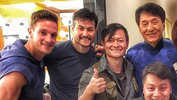 <p>Josh Fried '06 posing with actor Jackie Chan and friends on the set of a commercial.</p>