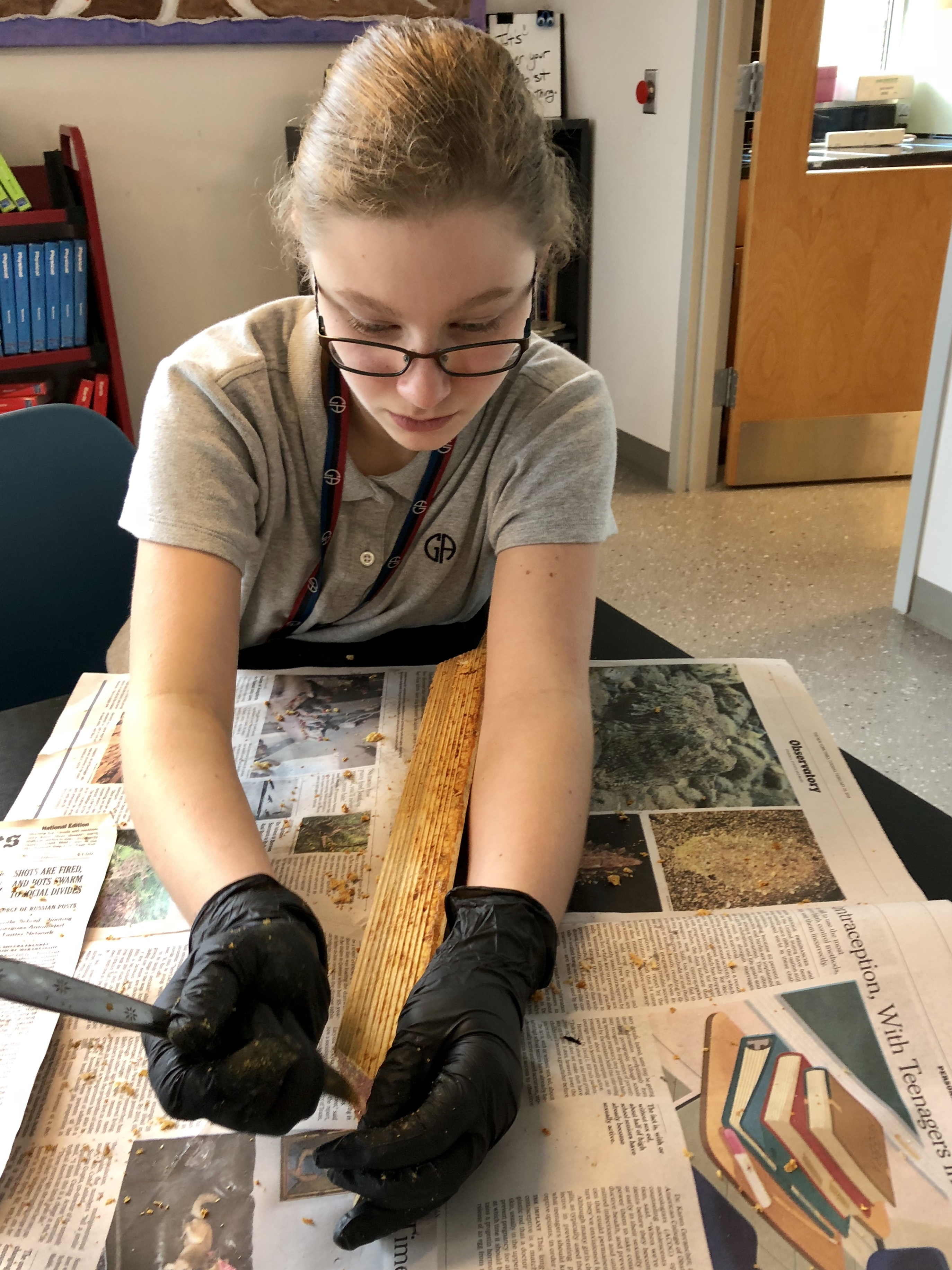 Middle School Green Ambassadors Clean Bee Frames